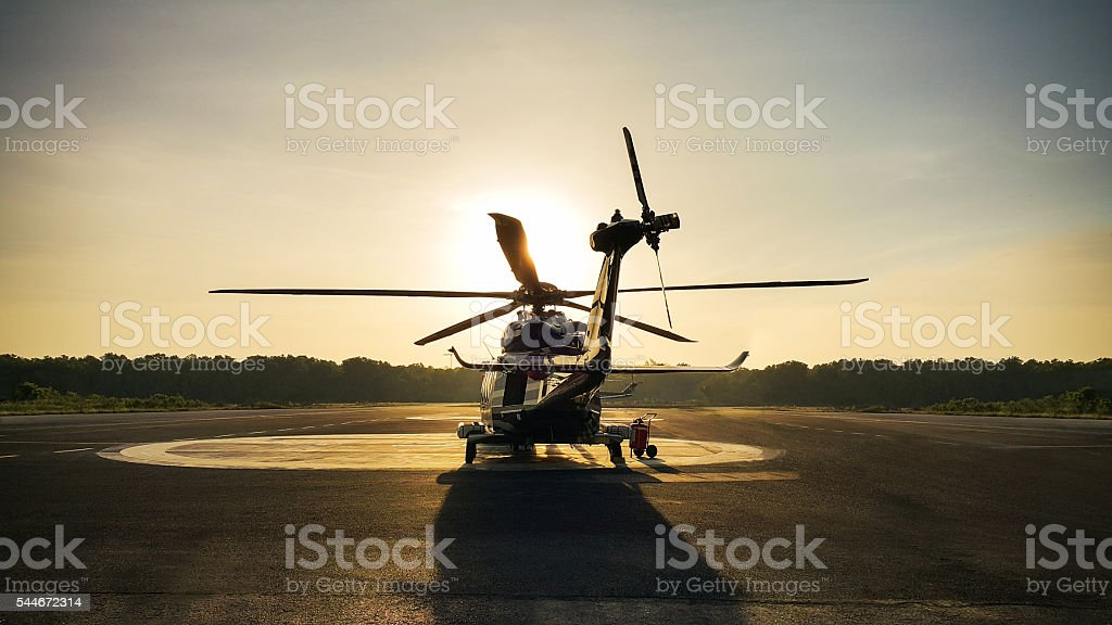 helicopter parking landing on offshore platform, Helicopter transfer passenger stock photo
