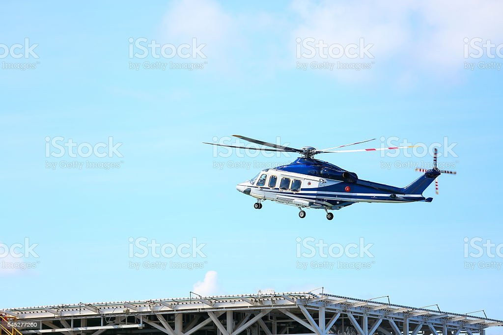 helicopter parking landing on offshore platform, Helicopter transfer crews stock photo