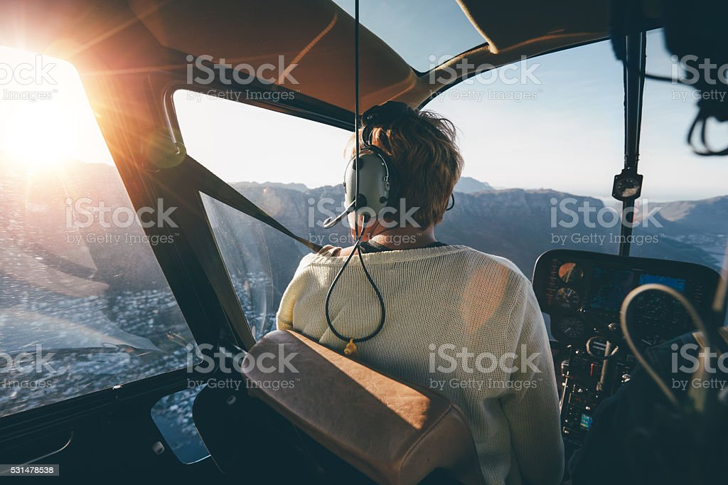 Helicopter passenger admiring the view stock photo