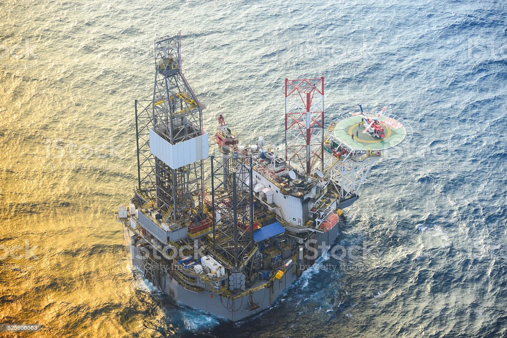 helicopter pick up passenger on the offshore oil rig. stock photo