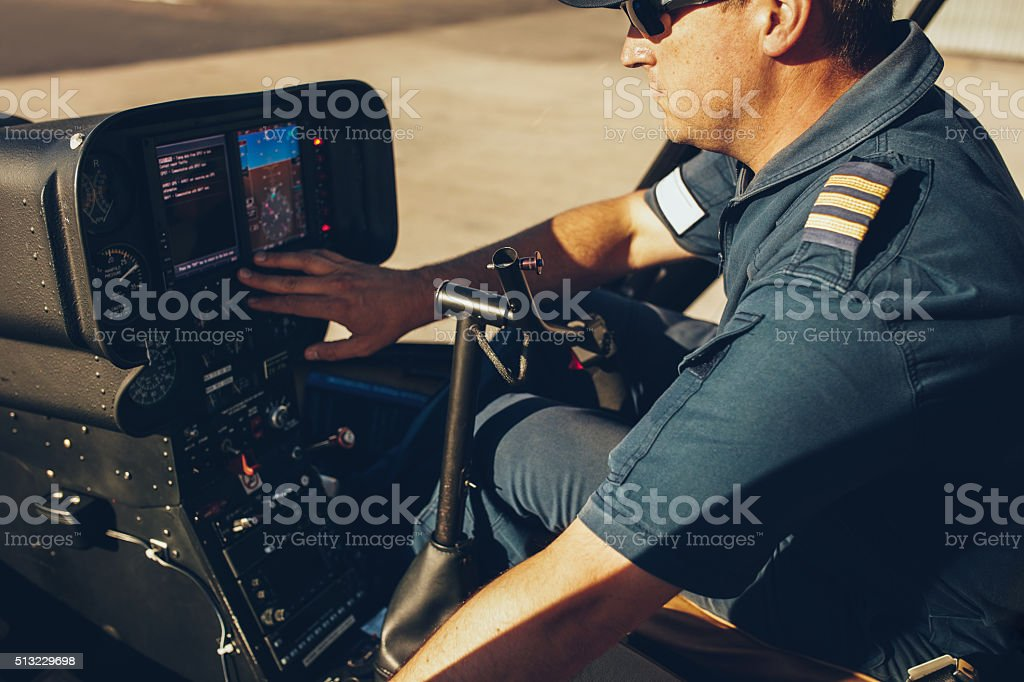 Helicopter pilot checking the gauges stock photo
