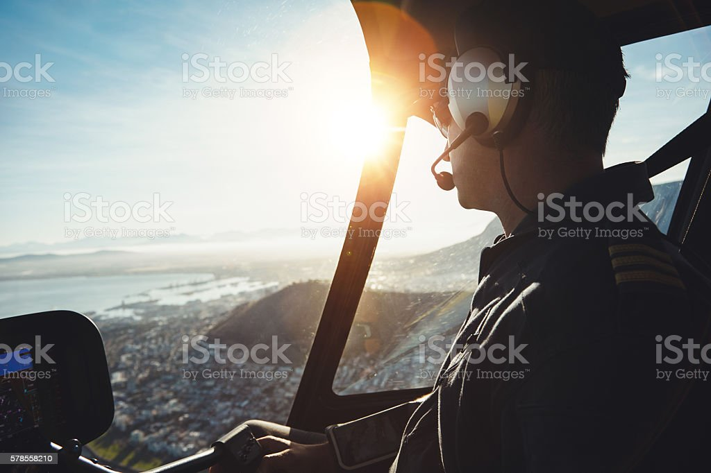 Helicopter pilot flying aircraft over a city stock photo