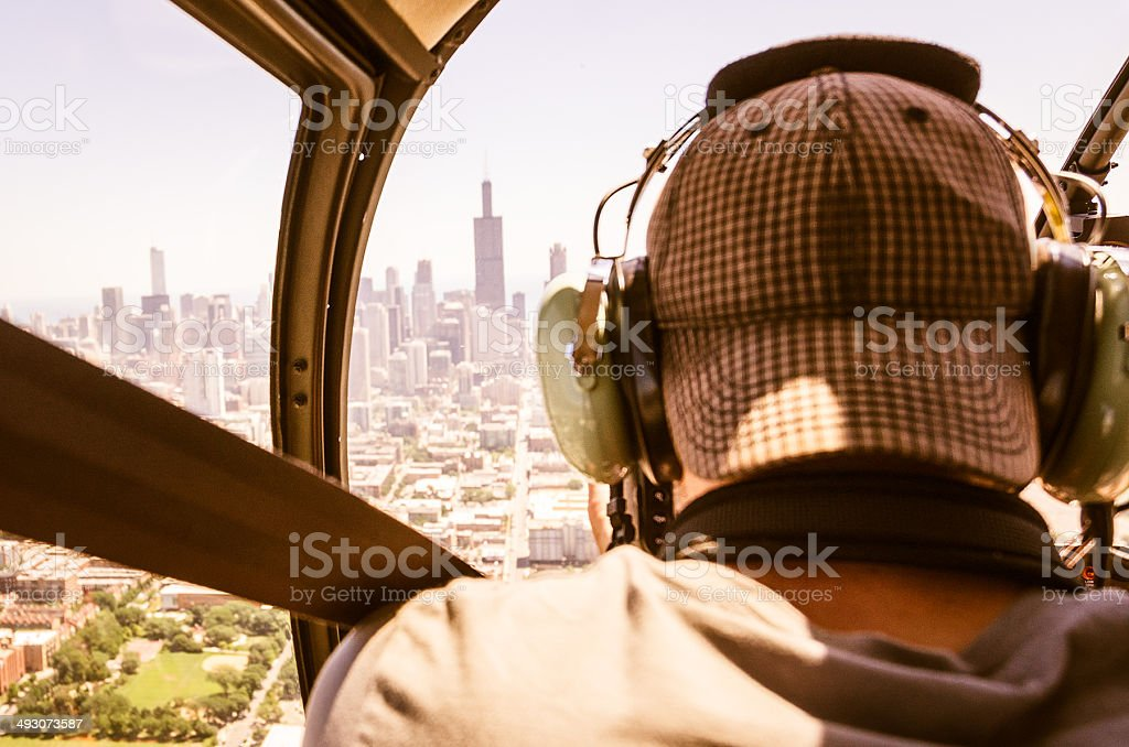 Helicopter Pilot over the chicago skyline stock photo