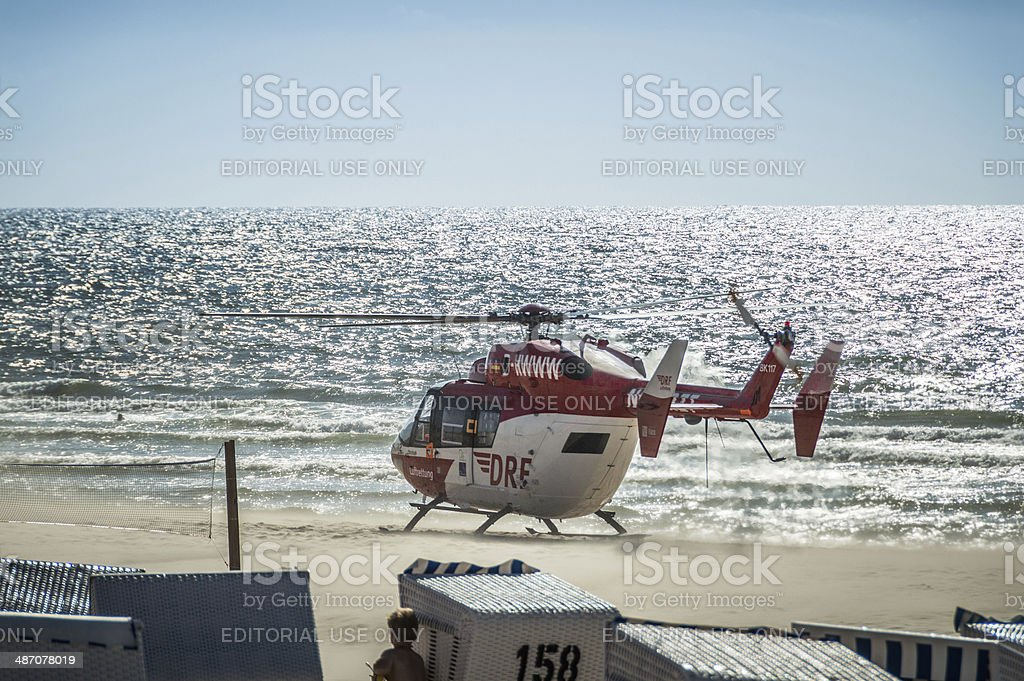 Helicopter Rescue Mission on the Beach royalty-free stock photo