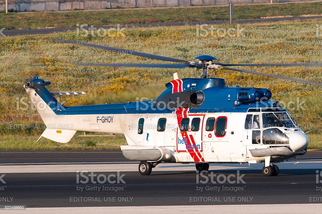 Helicopter serving rigs in the middle of the Mediterranean stock photo