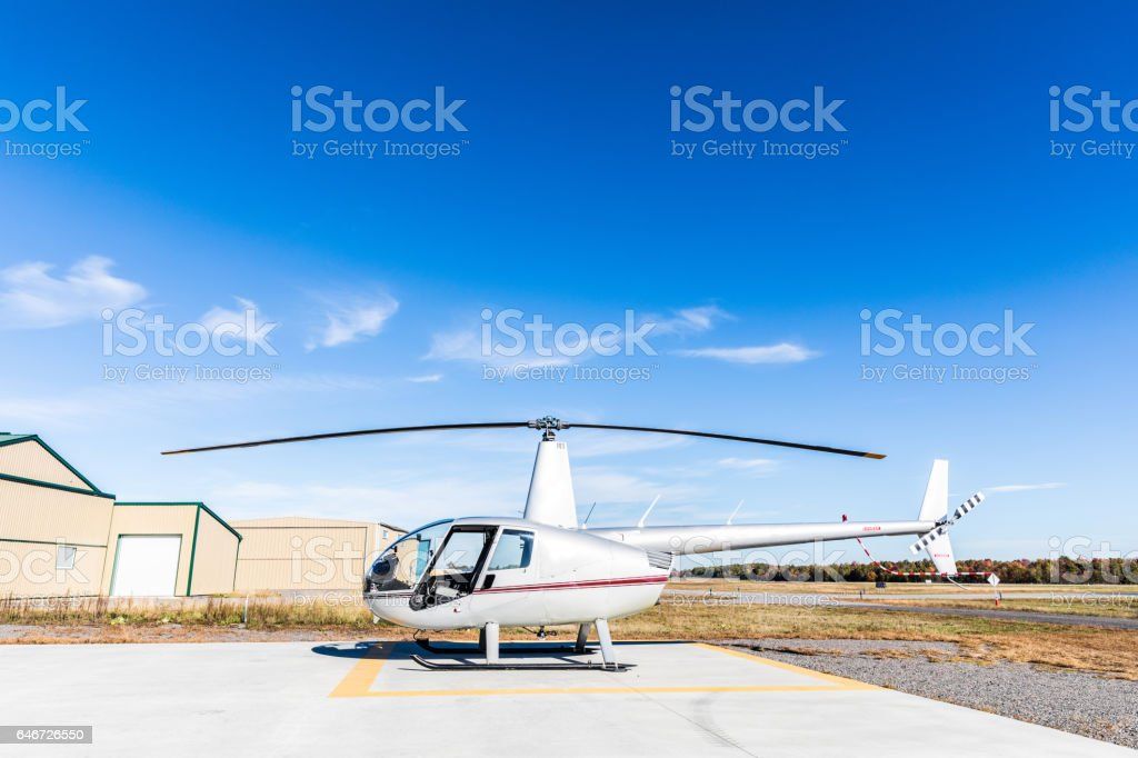 Helicopter side view at heliport stock photo