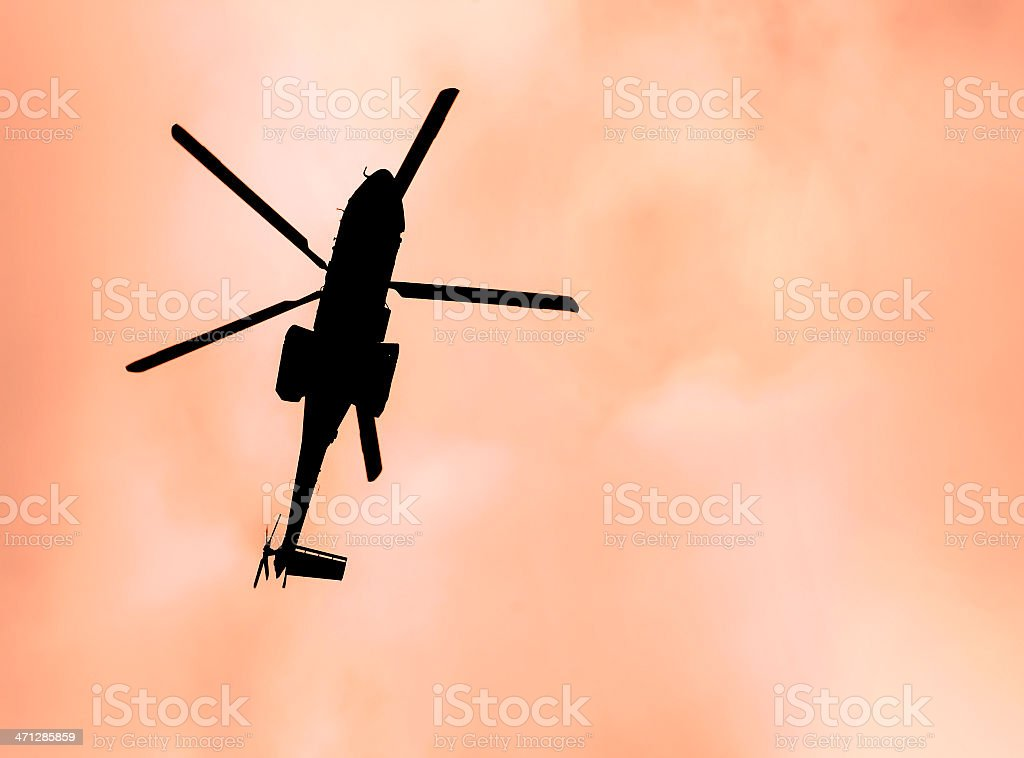 Helicopter Silhouette Against Sunset Sky stock photo
