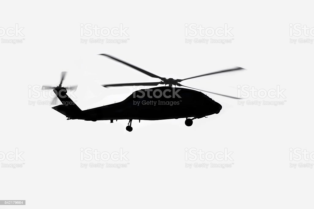 Helicopter silhouette.  Off-white background.  Copy space. stock photo
