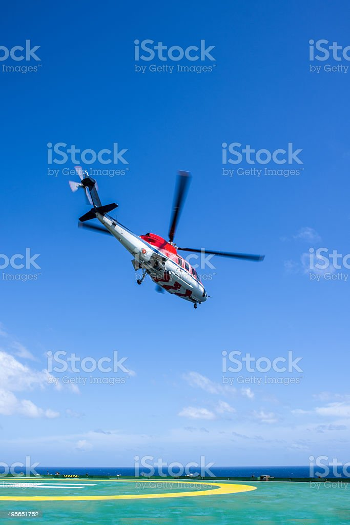 Helicopter take off from oil rig stock photo