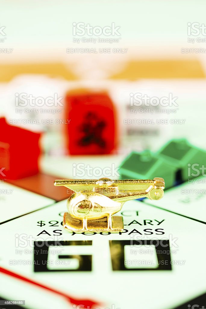 Helicopter Token on Monopoly Board royalty-free stock photo
