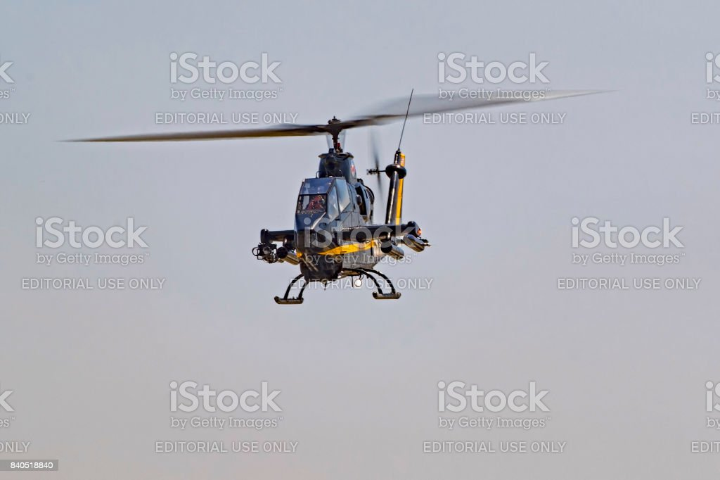 Helicopter UH-1 Cobra flying at air airshow stock photo