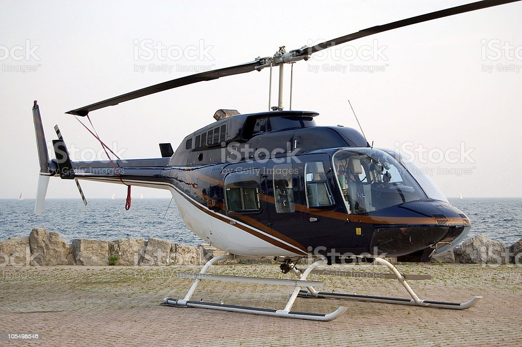 Helicopter under the sunset stock photo