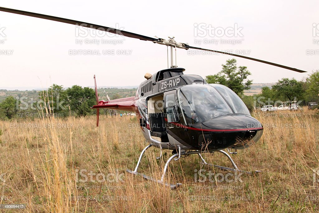 Helicopter used to dart animals from air stock photo