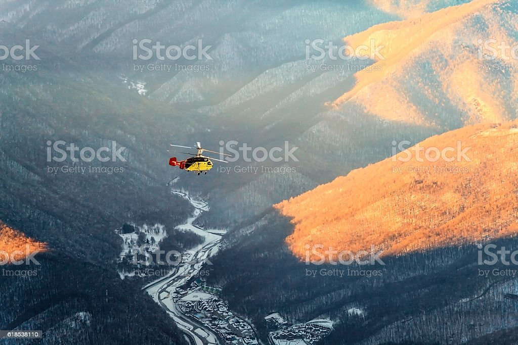 Helicopter winter mountain aerial view stock photo