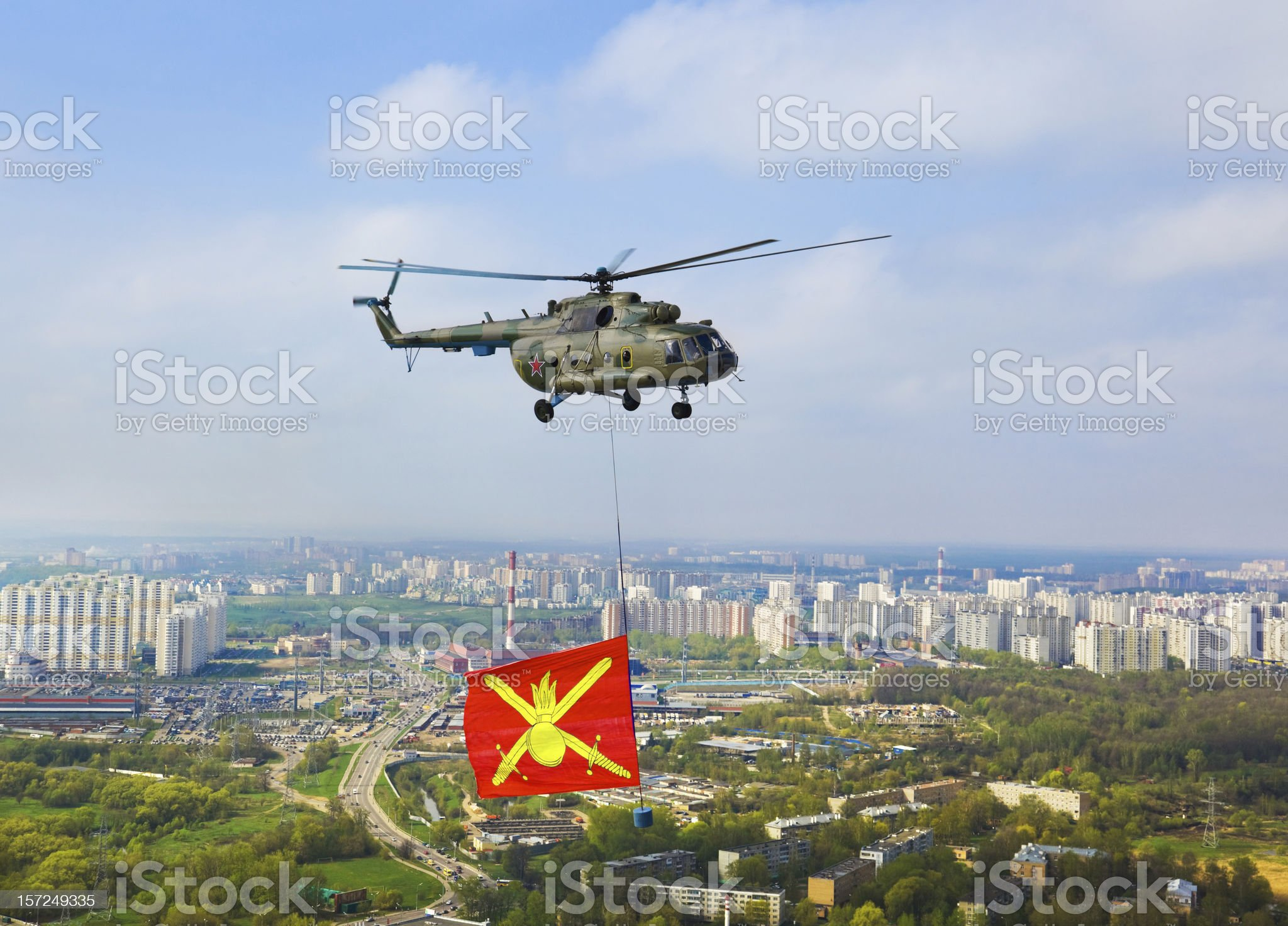 Helicopter with military flag over Moscow royalty-free stock photo