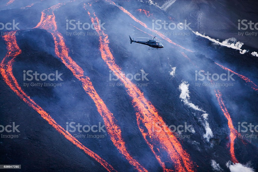 Helicopter with turists flying over the lavafalls at Fimvorduhals. stock photo