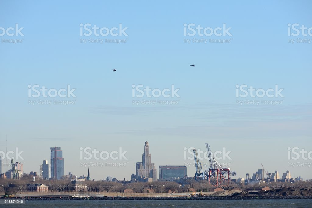 Helicopters above skyscrapers and cranes stock photo
