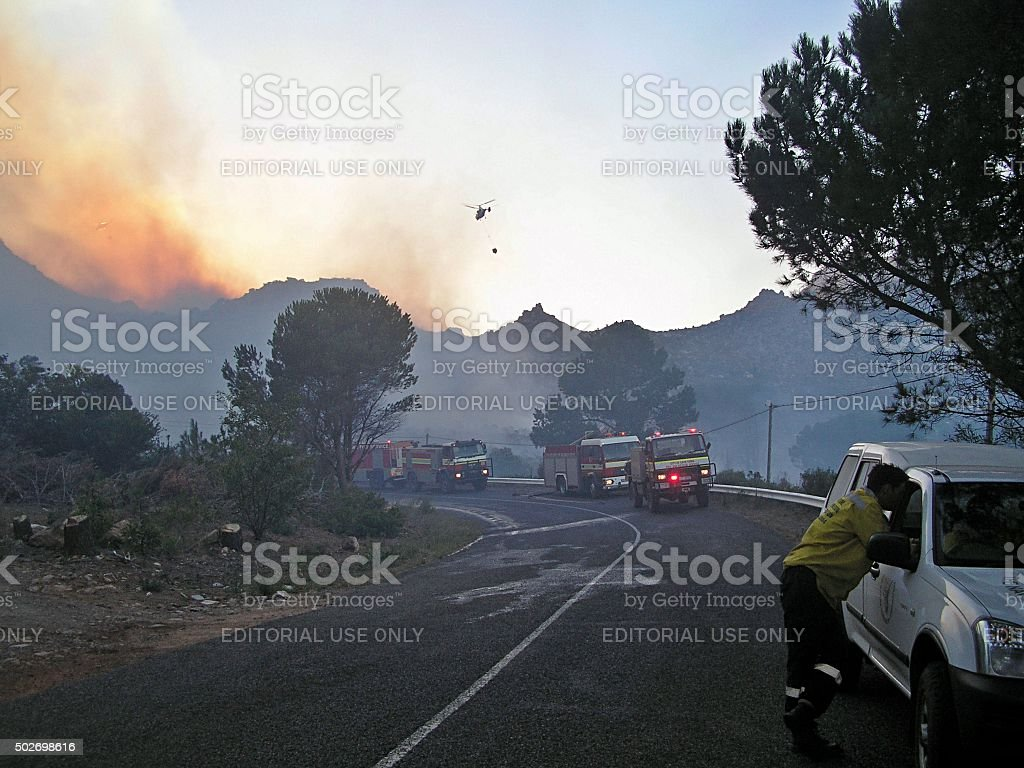 Helicopters arriving at dawn on a fire at Red Hill stock photo
