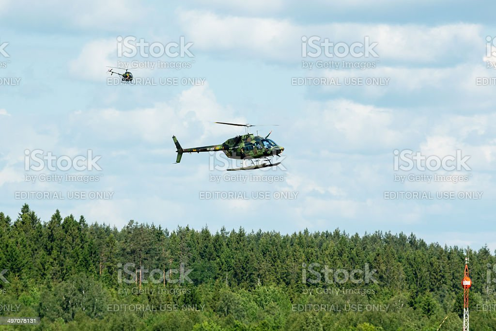 Helicopters in air stock photo