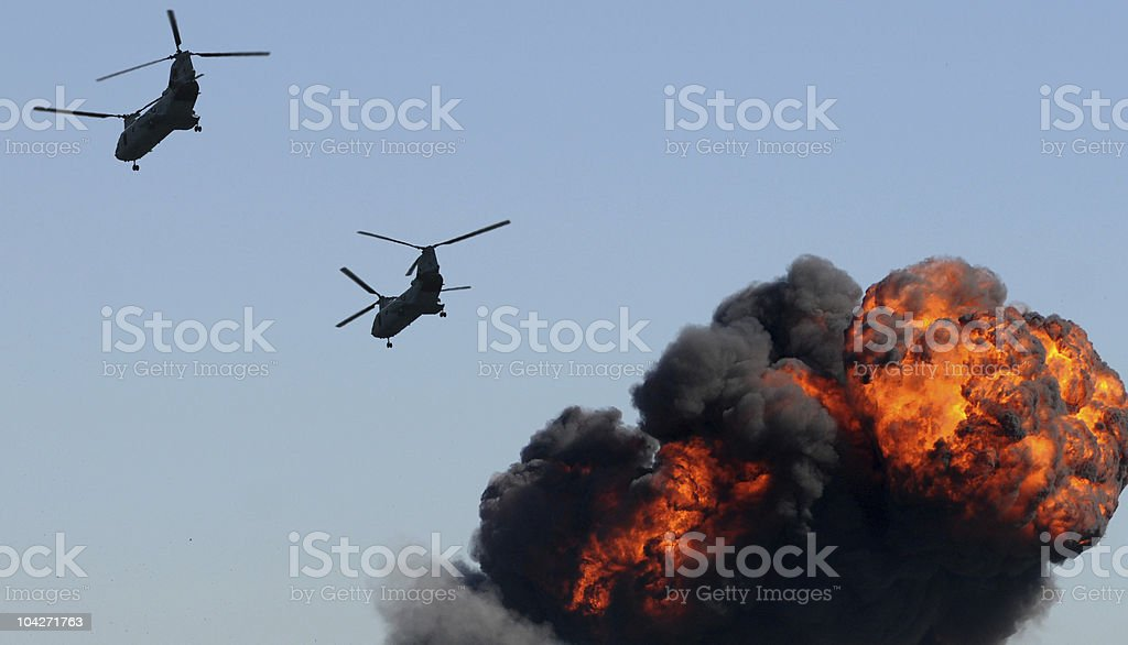 Helicopters over fire royalty-free stock photo