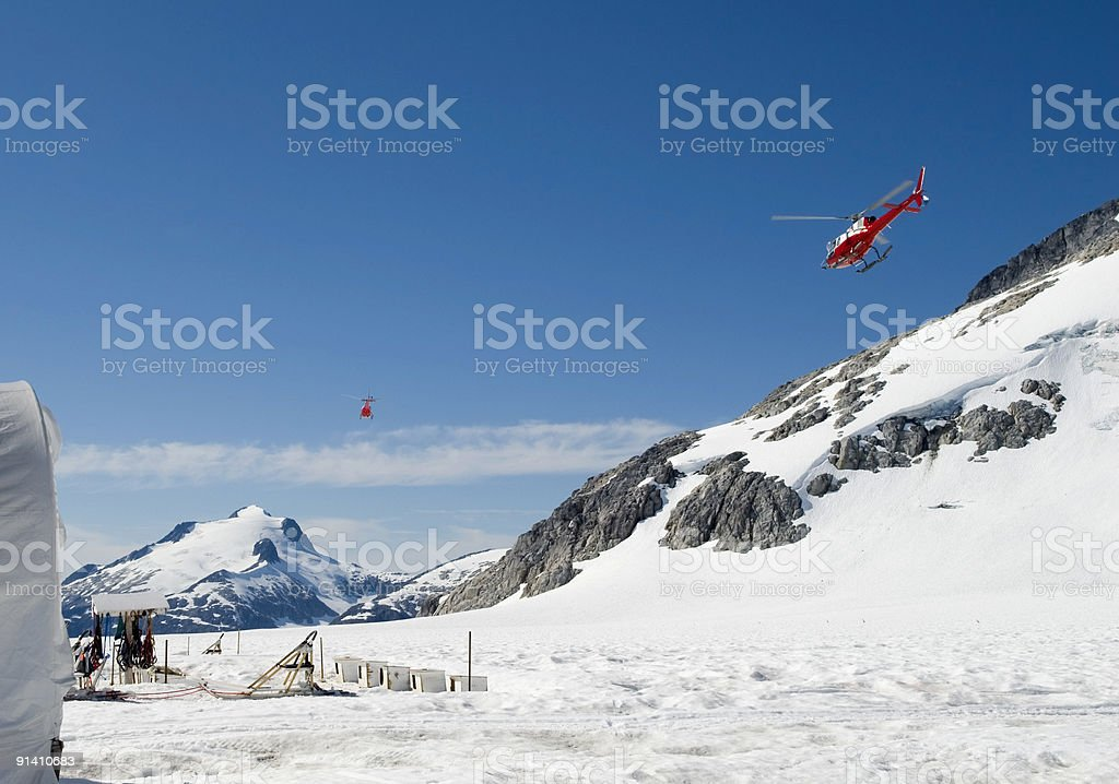 Helicopters Over Snow Field stock photo