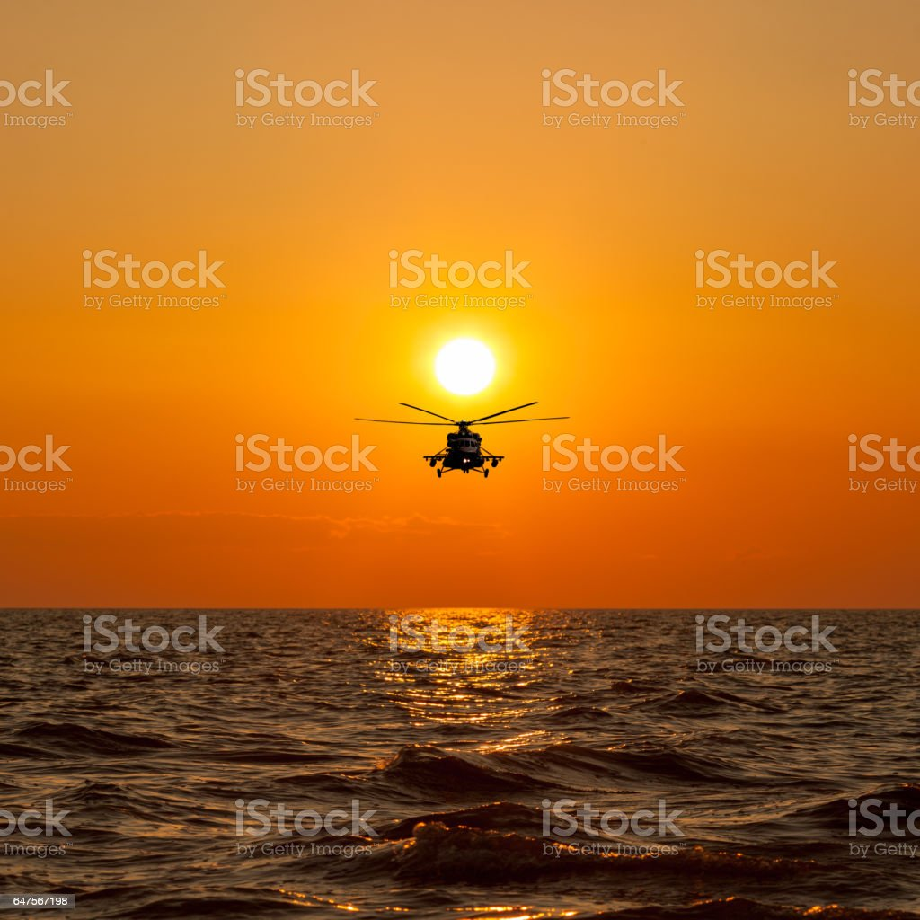helicopters, warm sunset stock photo