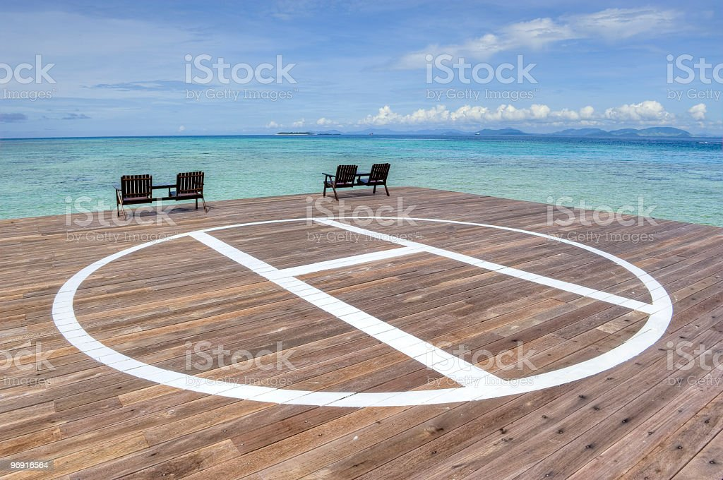 Helideck on platform in ocean stock photo