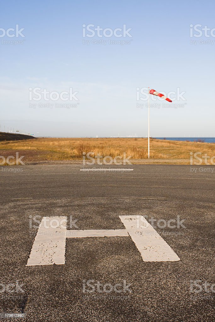 Helipad close to the water. Focus on big H. royalty-free stock photo