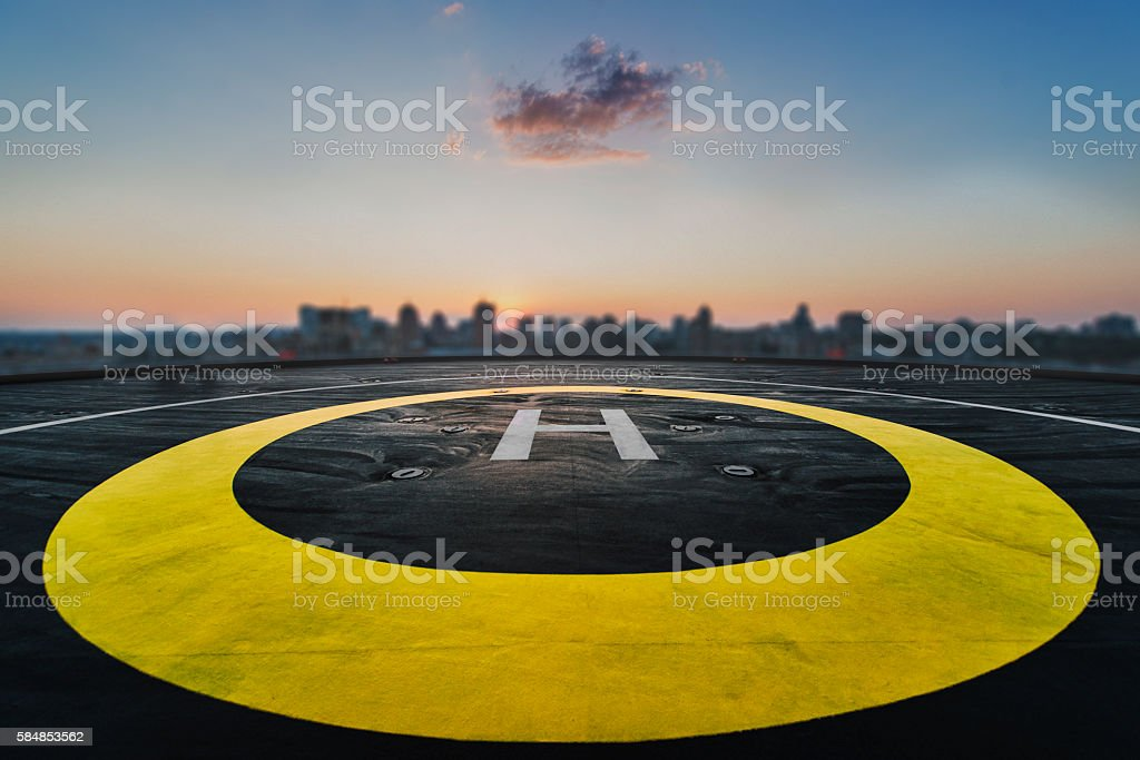 Helipad on the roof of a skyscraper with cityscape view stock photo