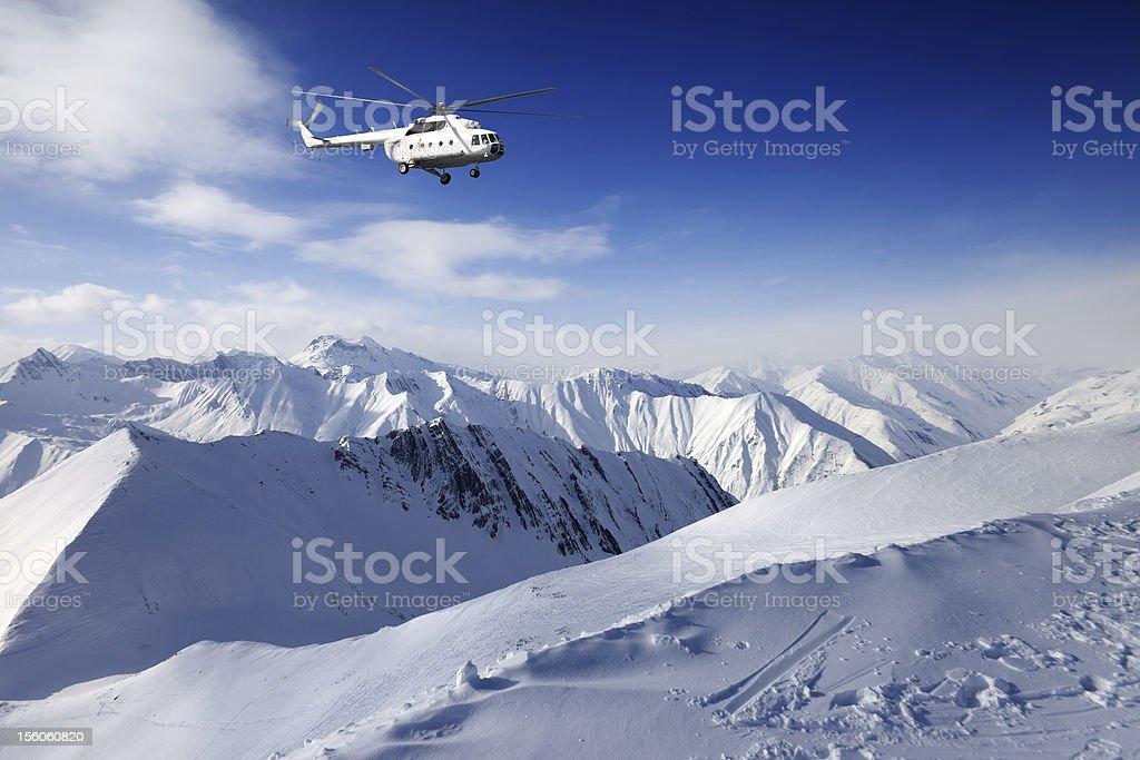 Heliski in snowy mountains royalty-free stock photo