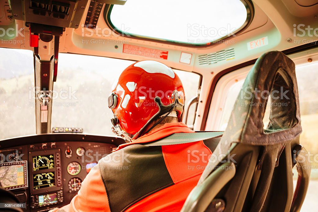 Heli-Transport - Pilot Flying Helicopter in Swiss Alps stock photo