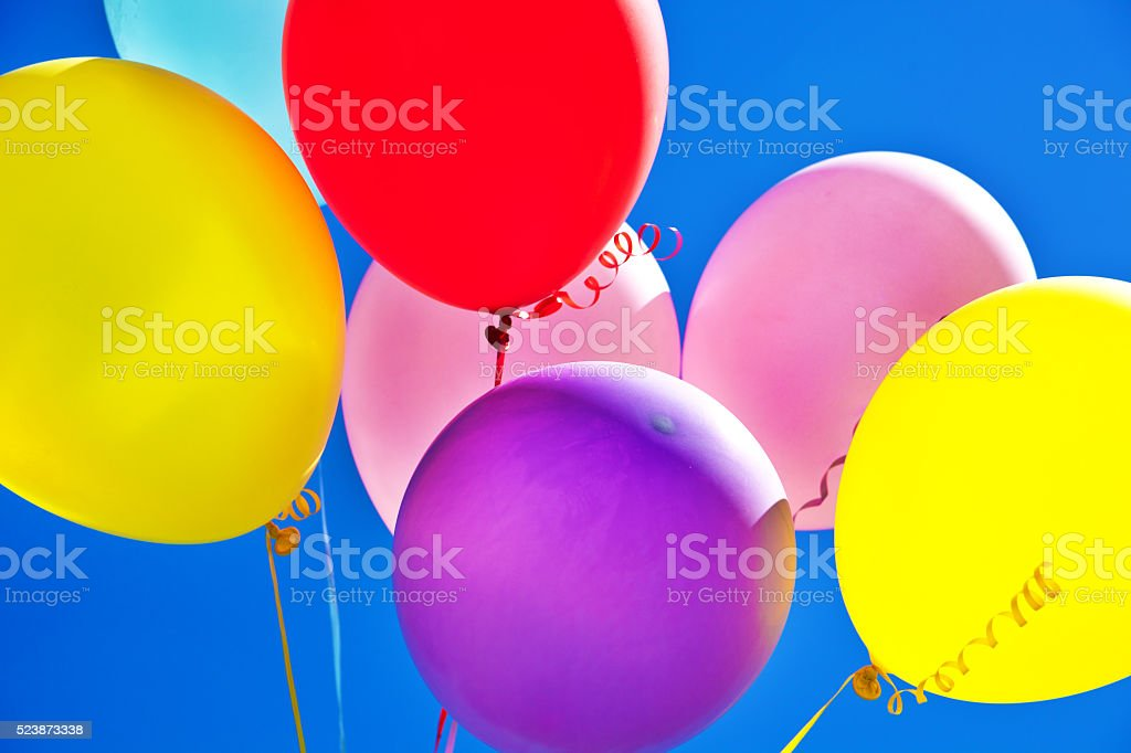 Helium Party Balloons Against Sky for Celebration Events stock photo