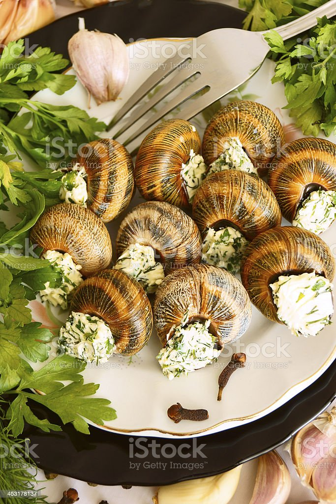 Helix pomatia with garlic and herbs. royalty-free stock photo