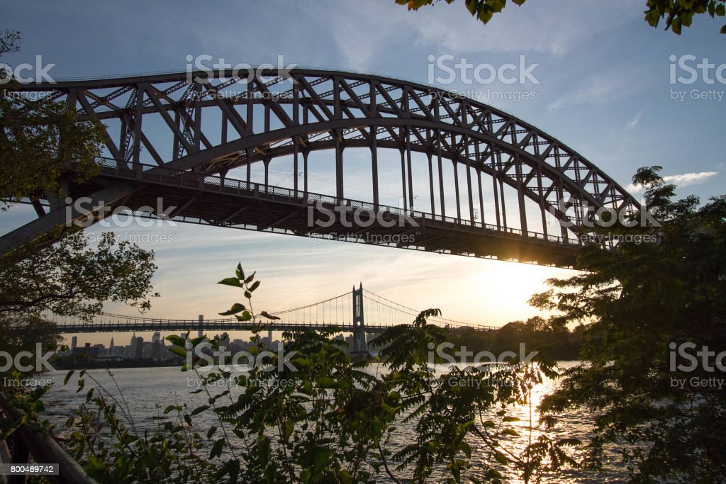 Hell Gate Bridge and Triborough bridge over the river before sunset, New York stock photo
