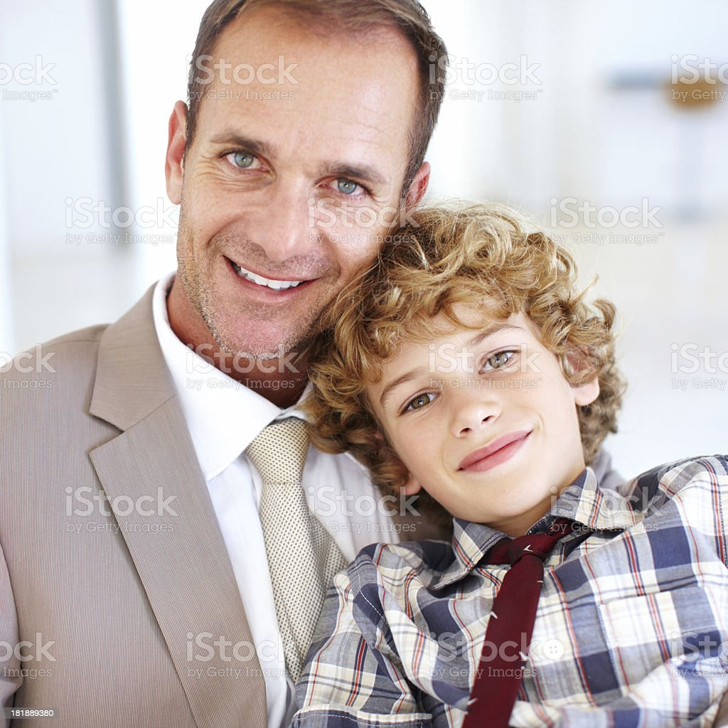 He'll grow up to be just like his father royalty-free stock photo