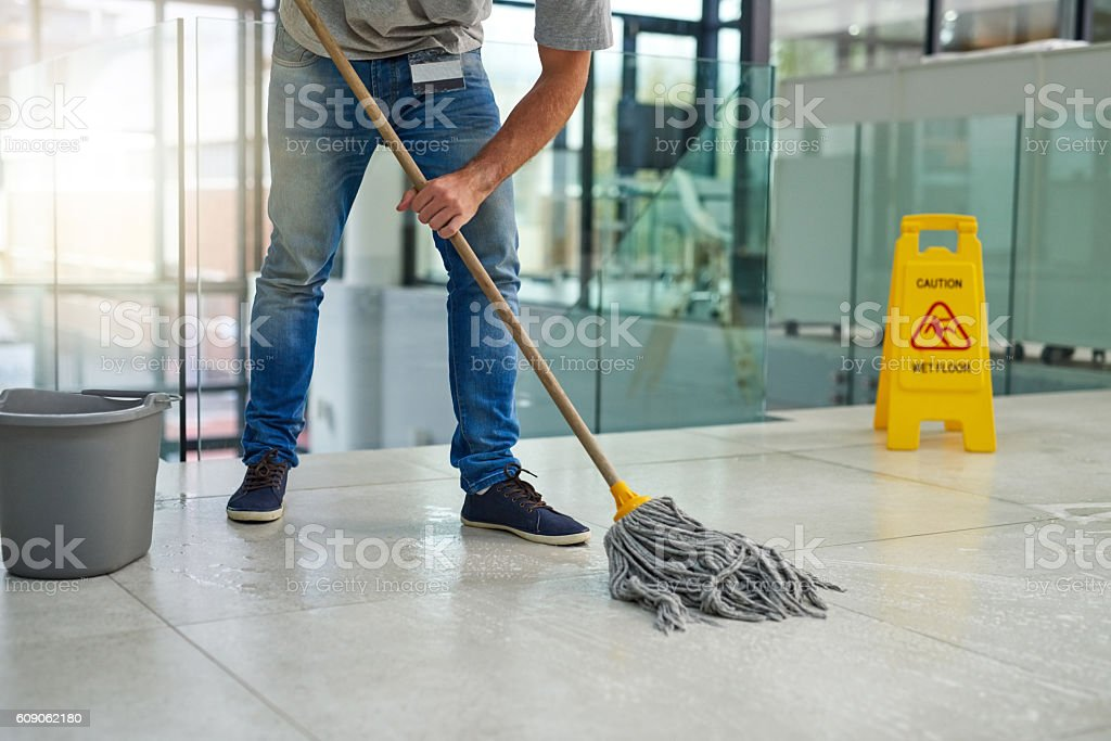 He'll leave that floor spotless stock photo
