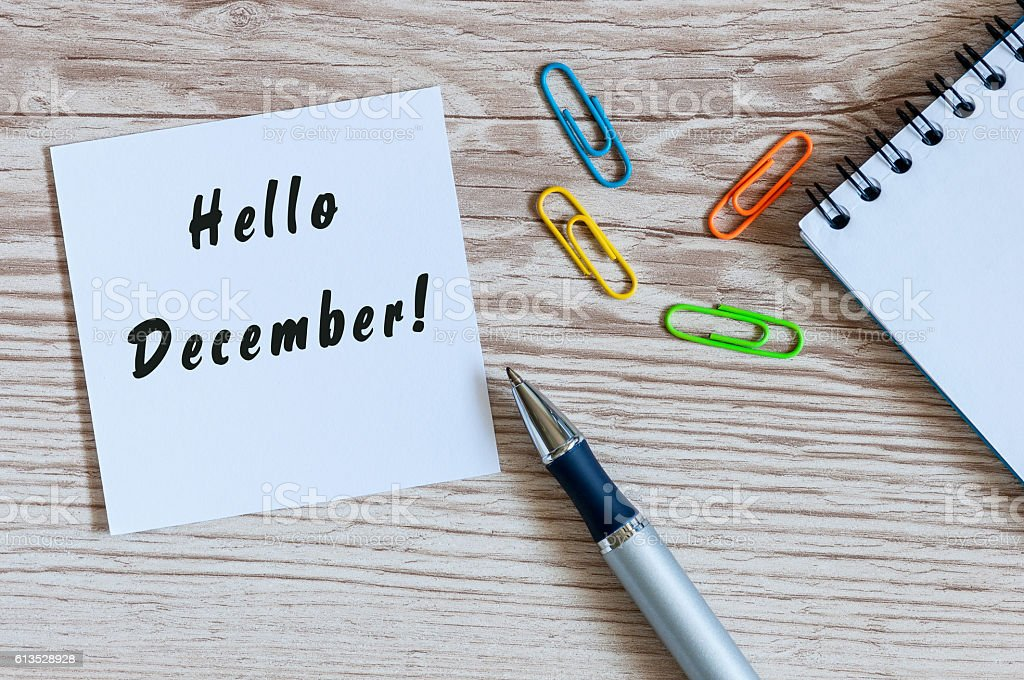 Hello December written on paper at work table. Eve, Christmas stock photo