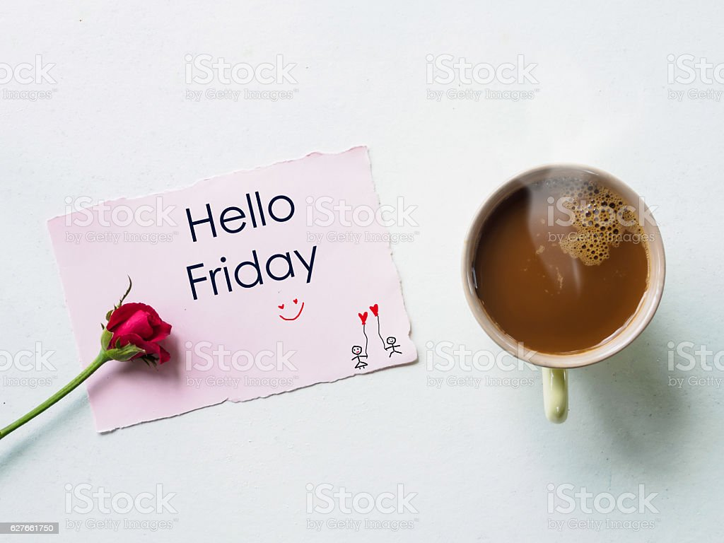 Hello Friday message coffee mug with red rose flowers stock photo