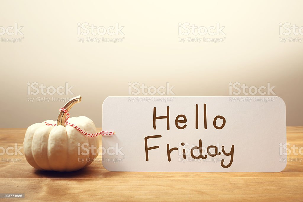 Hello Friday message with small pumpkin stock photo