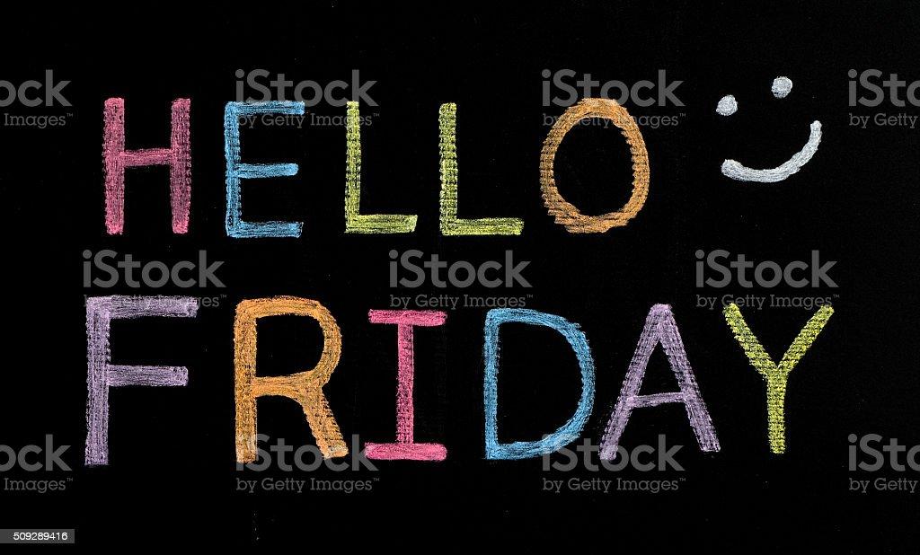 Hello Friday written on blackboard stock photo