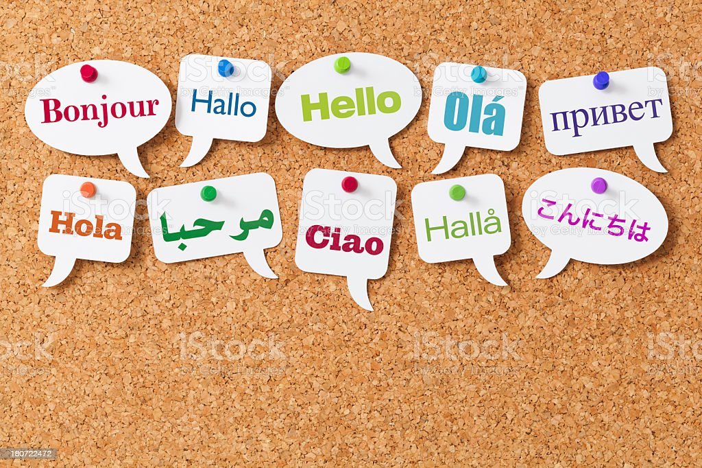 Hello in ten different languages on white speech bubbles stock photo