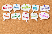 Hello in ten different languages on white speech bubbles