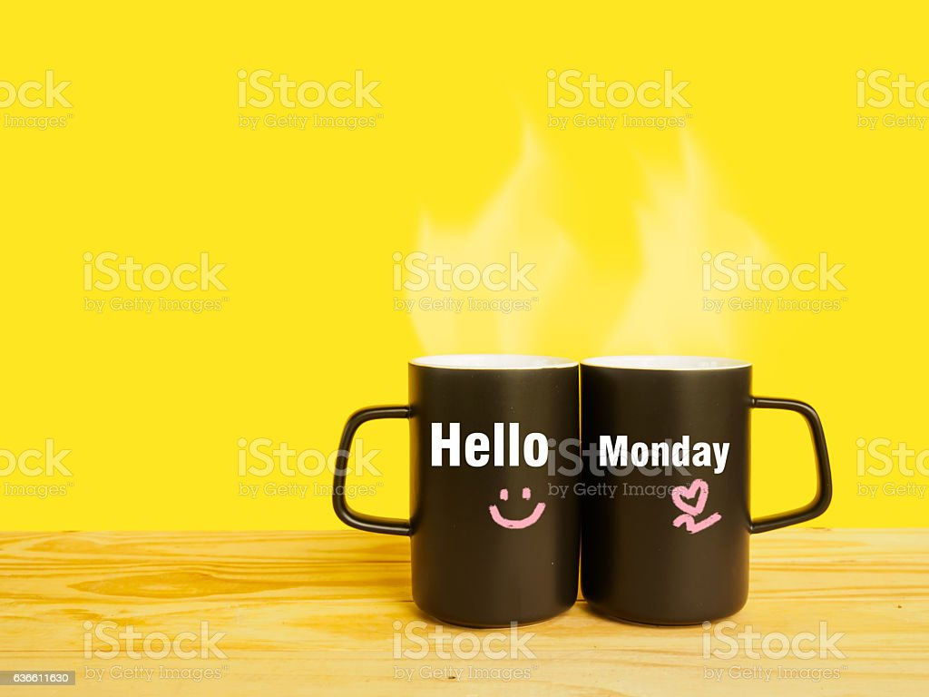 Hello Monday message on couple coffee or tea cup stock photo