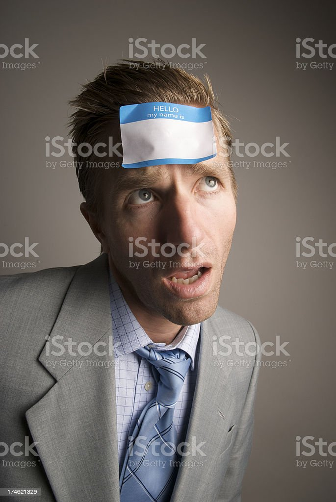 Hello My Name Is What The...? Businessman Wearing Nametag royalty-free stock photo