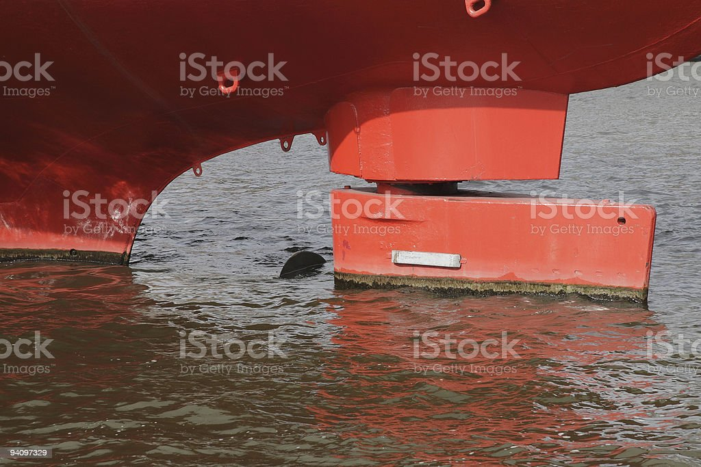 Helm at a red ship's hull stock photo