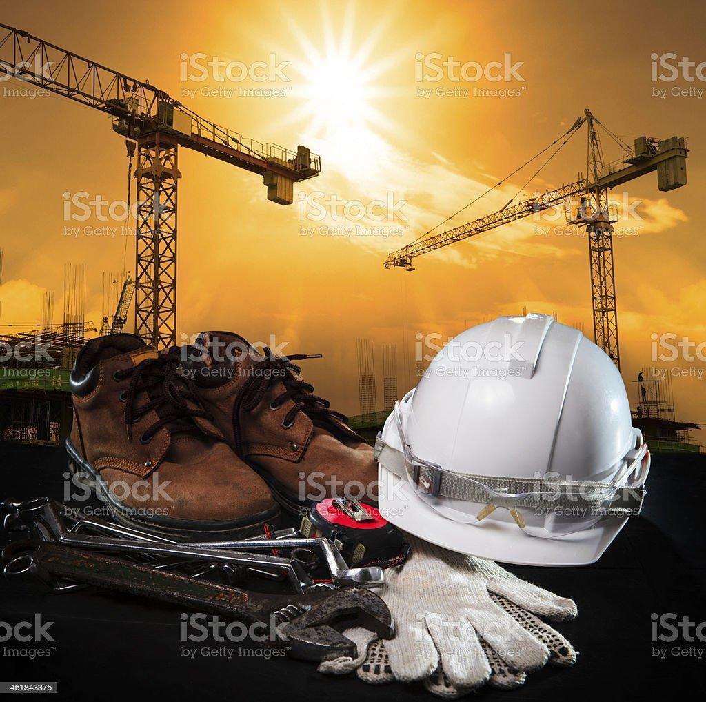 helmet and construction equipment stock photo
