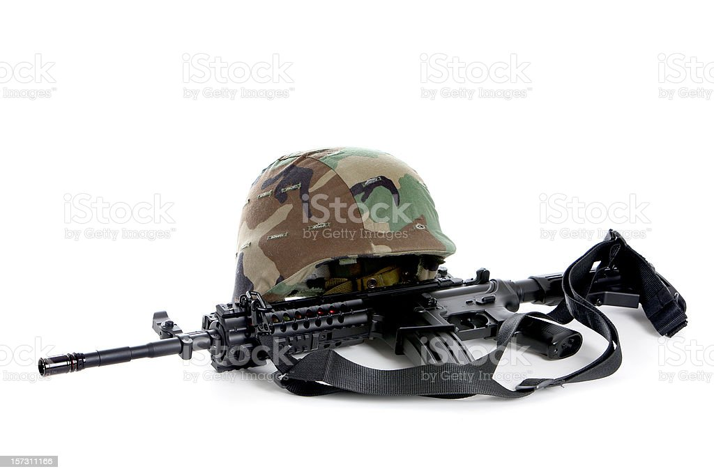 Helmet and rifle royalty-free stock photo