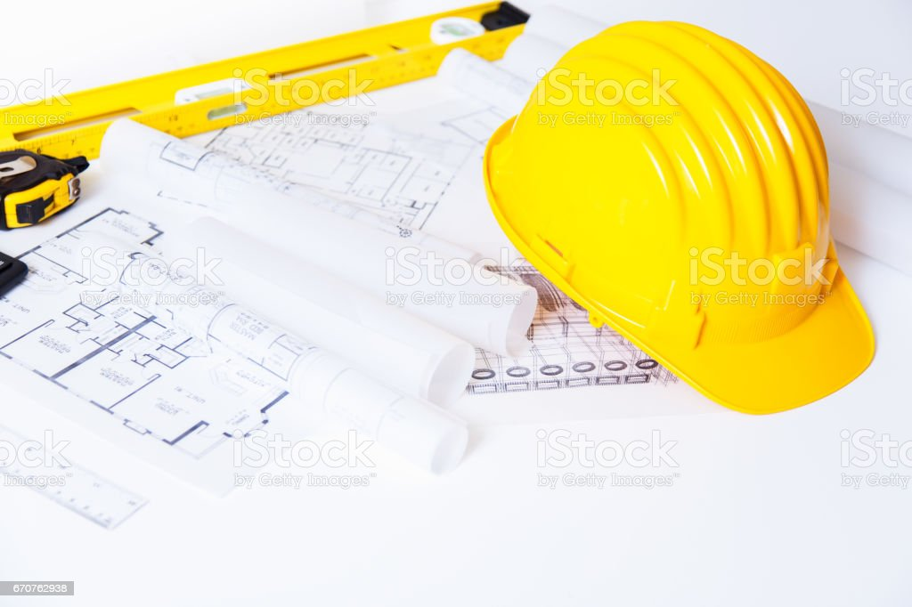 Helmet and tools for construction drawings and buildings stock photo