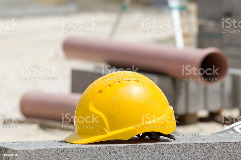 Helmet at construction site stock photo