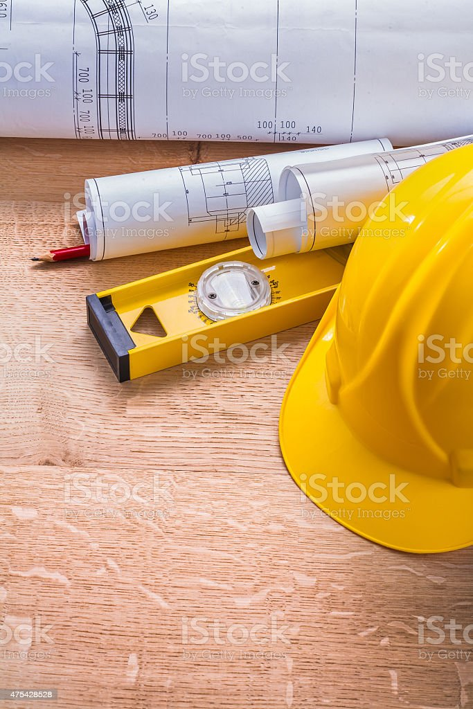 helmet blueprints level pencil on wooden board stock photo